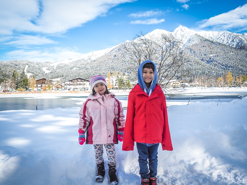 Our kids in front of Wildsee, a lake in Seefeld, when it was covered in snow and ice